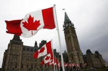 7月10日、TPP交渉の早期妥結を目指す米政府が、カナダ抜きでの決着に踏み切る緊急対応策を検討していることが関係筋の話で分かった。写真は2014年5月、カナダ首都オタワの議事堂前で撮影(2015年 ロイター/Blair Gable)
