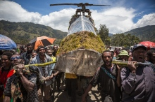 People during the peace treaty celebration in Kundiawa town, Papua New Guinea. They prepared the wooden helicopter to carry Kerenga Kua, the former PNG Minister for Justice, who was born in Kundiawa.