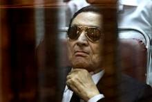 FILE - In this Saturday, April 26, 2014 file photo, ousted Egyptian President Hosni Mubarak attends a hearing in his retrial over charges of failing to stop killings of protesters during the 2011 uprising that led to his downfall, in the  Police Academy-turned-court in the outskirts of Cairo, Egypt.  Egypt's deposed leader Hosni Mubarak and his two sons were sentenced Saturday to three years in prison and a fine in a retrial on corruption charges they faced earlier. It wasn't immediately clear whether it will include time he's already served since his country's 2011 revolt.  (AP Photo/Tarek el Gabbas, File)